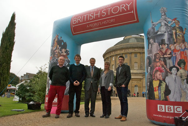 BBC team photographed in front of inflatable arch