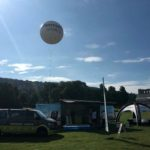 TomTom helium filled inflatable sphere in a festival field