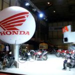 Honda sphere supported above exhibition stand