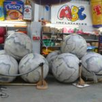 Giant push balls with grey boulder-like artwork