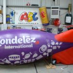 Hand painted artwork on Mondelēz International blimp in workshop