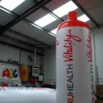 2 giant inflatable replica water bottles branded PruHealth