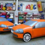 Life-sized inflatable orange cars