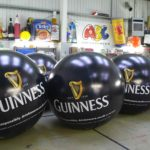 6 giant branded Guinness pushballs in ABC Inflatables workshop
