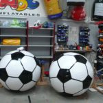 2 large replica footballs inflated in our workshop