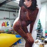 Giant inflatable shape with woman artwork