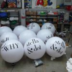 10 white push balls for stella & dot in our workshop