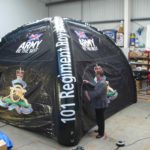 Zipped doors on inflatable branded tent