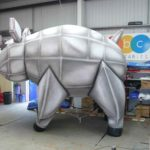 Grey robotic looking giant inflatable pig in our workshop