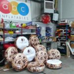 Group of round inflatable cushions with Double Tree branding