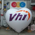 Giant white Vhi inflatable heart with branding