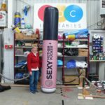 Giant product replica inflatable Sexy Mother Pucker lipstick with lady in workshop