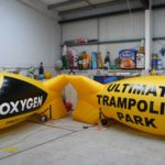 2 yellow airship site markers for Oxygen Trampoline Park