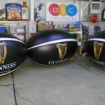 4 inflatable replica rugby balls with Guinness branding by ABC Inflatables