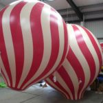 red and white striped balloon spheres
