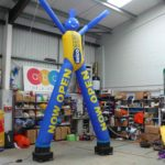 2-legged sky dancer with Selco branding in ABC Inflatables workshop