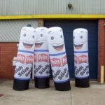 4 inflatable Pritt stick replicas outside ABC Inflatables' workshop