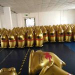 Room filled with inflatable gold Lindt Bunnies