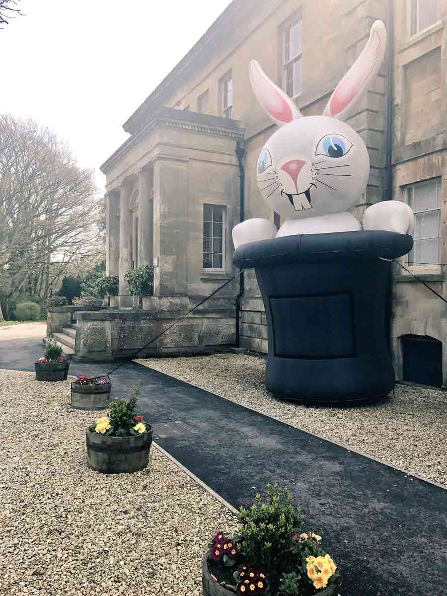 giant inflatable rabbit emerging from top hat