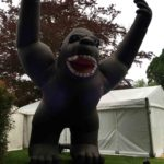 Inflatable gorilla towering over marquees