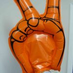 Orange inflatable victory salute hand