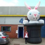 Lady standing by huge rabbit inflatable
