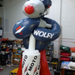 Wolfy character holding Dafy Moto exhaust