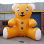 giant inflatable animals - bear outside ABC Inflatables