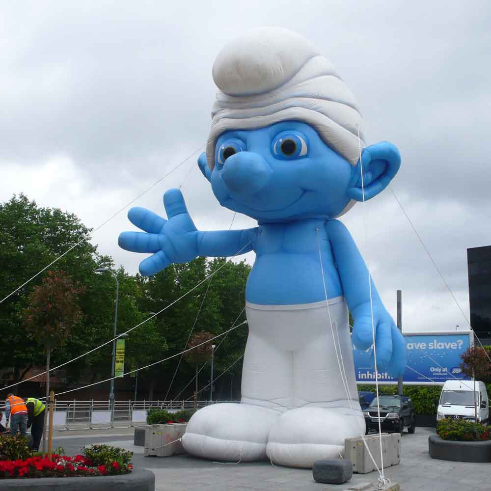 Huge Smurf inflated on a pavement