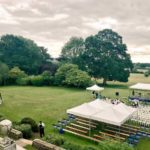 Country garden with rented marquees and seating for guests