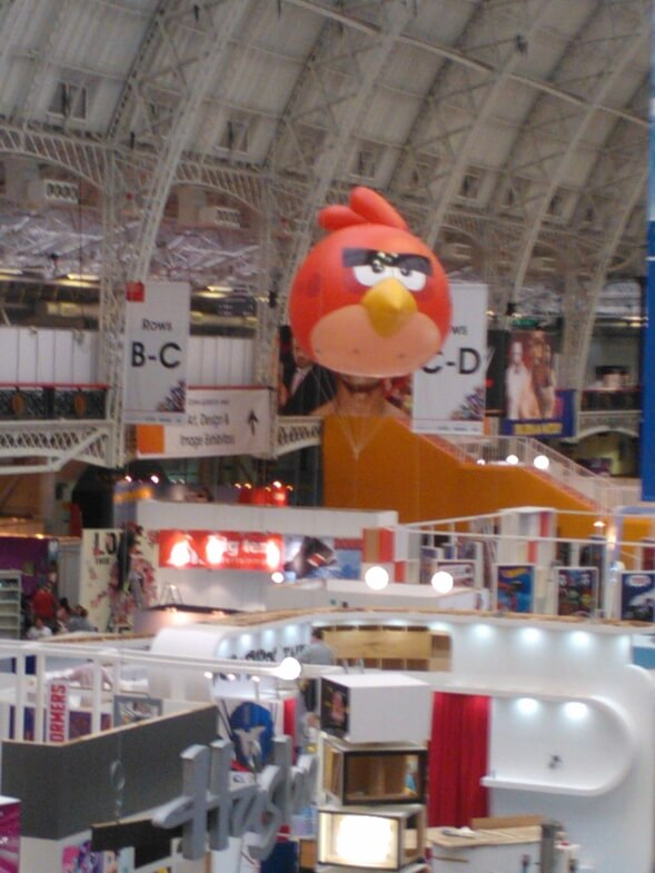 angry bird inflatable hovers over exhibition stand