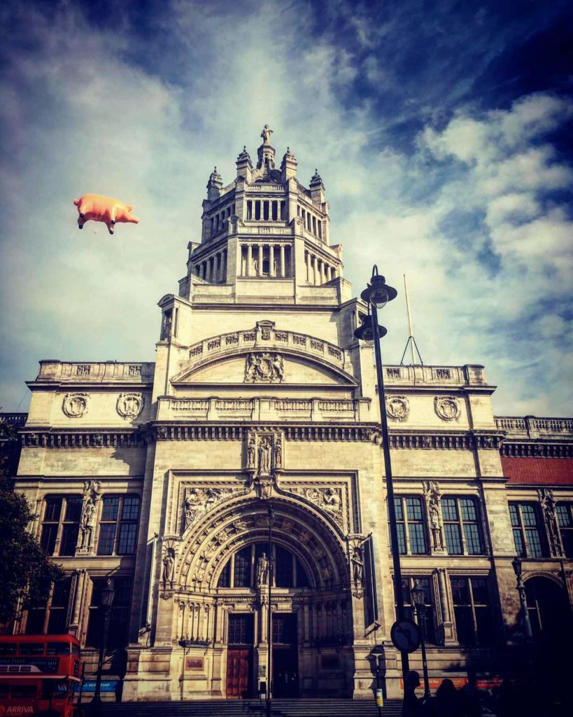 inflatable pig in sky above V&A