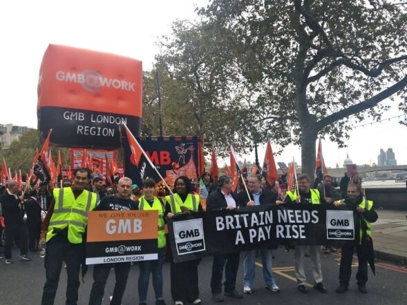GMB members demonstrating and carrying a giant inflatable sphere
