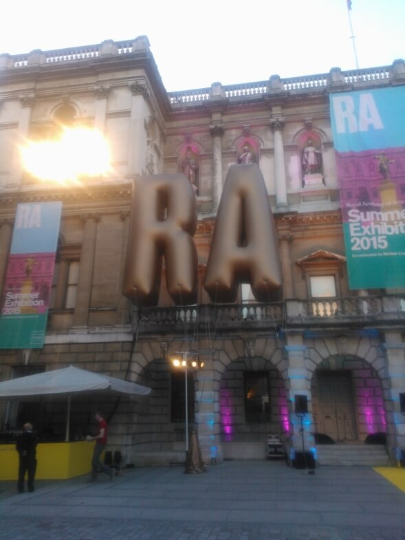 Gold inflatable letters outside Royal Academy