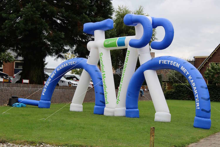 giant inflatable bike standing on grass