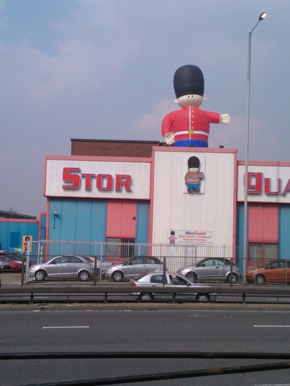 inflatable guardsman standing on roof