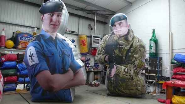 Two inflatable military men