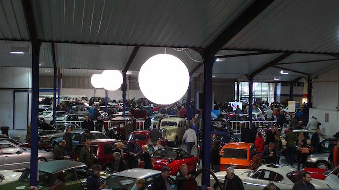 an auction of classic cars illuminated by ABC Inflatables light balloons