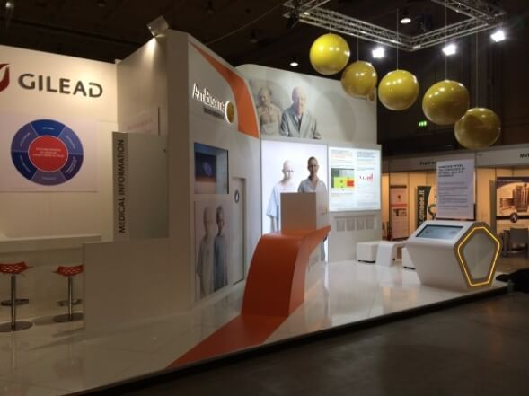 inflatable spheres hang above a stand at a medical show