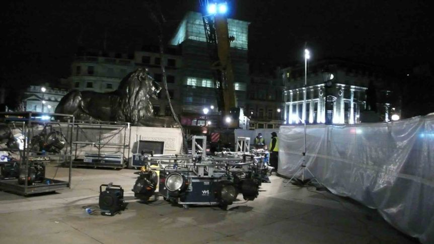 Lighting rig being set up next to one of Landseer's lion statues