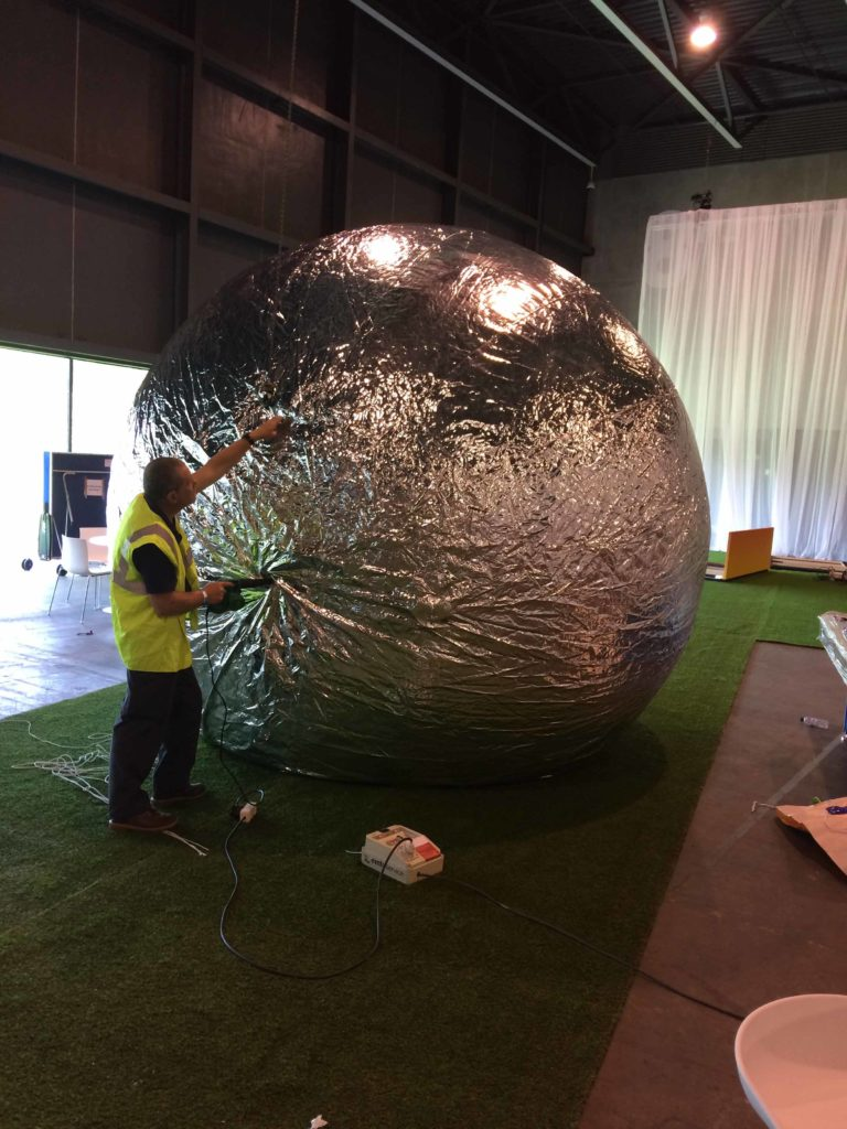 inflating a giant silver sphere