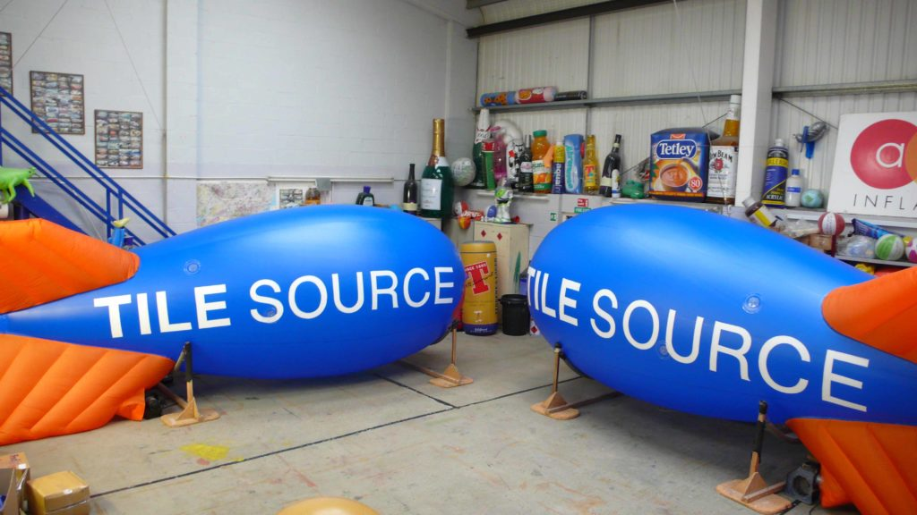 two blimps in workshop