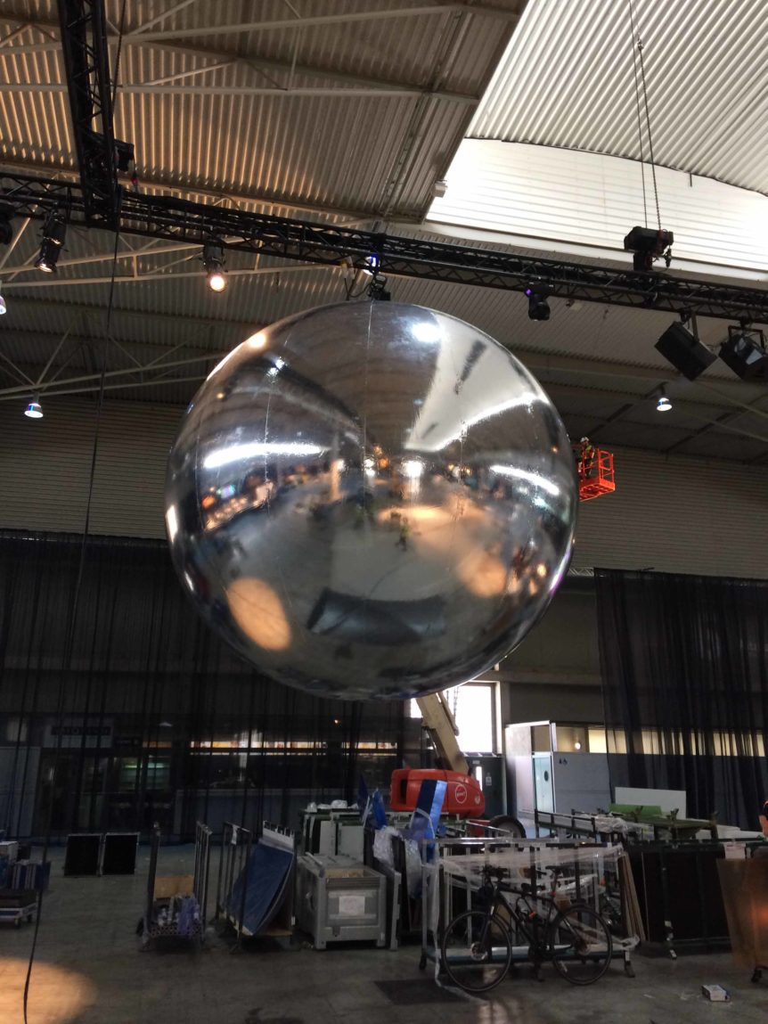 Giant mirror ball suspended over exhibition
