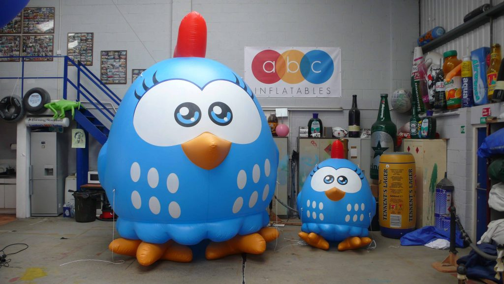 Two Inflatable chicken Lottie Dottie characters