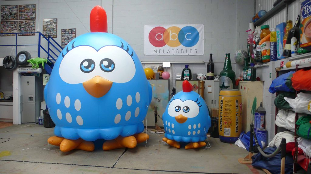 Big and small inflatable Lottie Dottie chickens