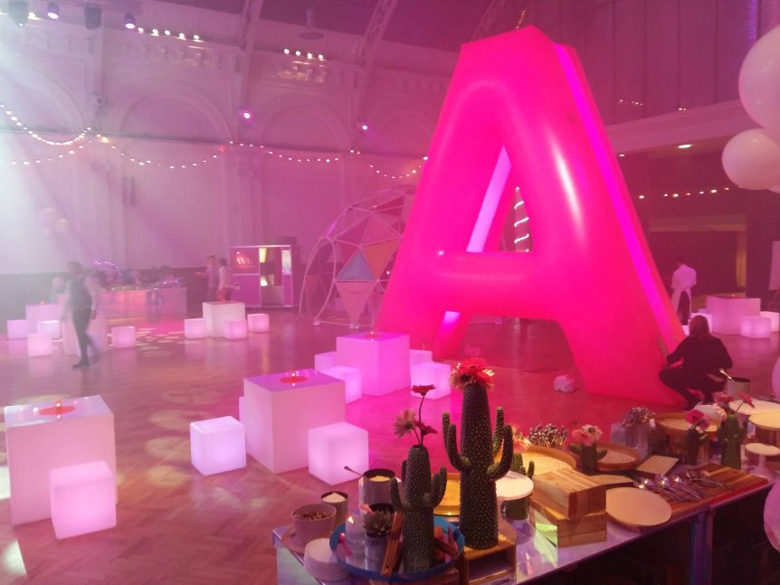 inflatable letter A illuminated at party