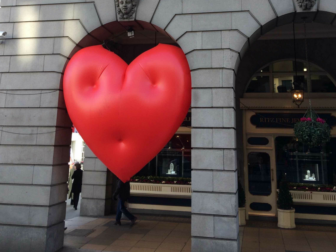 inflatable chubby heart squashed in archway