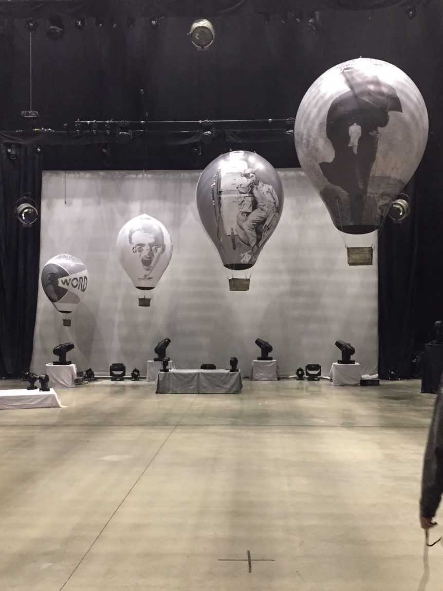 4 printed balloons above stage for Mike & the Mechanics