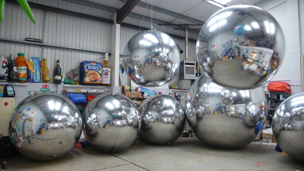 7 large inflatable mirrored spheres