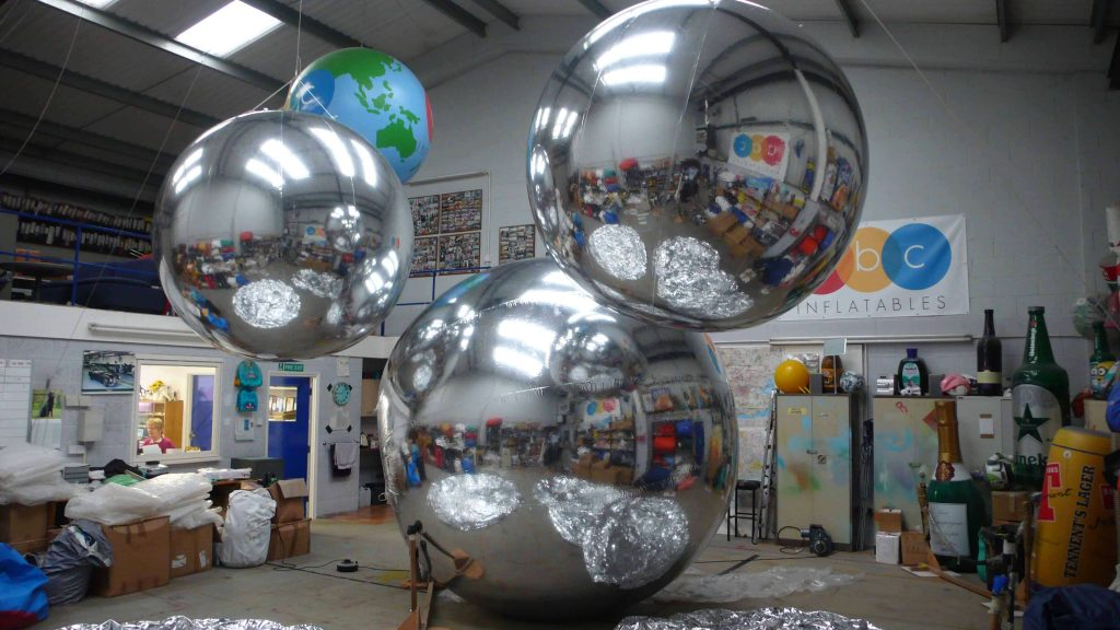 different sizes silver chrome inflatable spheres